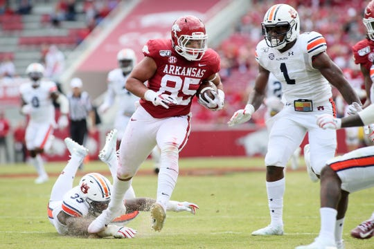 Arkansas tight end Cheyenne O'Grady (85) runs past Auburn defenders K.J. Britt (33) and Big Kat Bryant (1) for a touchdown after a catch at Razorback Stadium on Oct. 19, 2019, in Fayetteville, Ark.