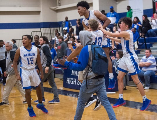 Marbury players celebrate after the game during the Class 5A boys subregional in at Marbury High School Deatsville, Ala., on Tuesday, Feb. 11, 2020. Marbury defeated Demopolis 56-46.