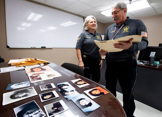 Autauga County Sheriff Joe Sedinger and investigator Lynn Sutton look through the case file of a cold case they are reopening at the sheriff's office in Prattville, Ala., on Wednesday February 12, 2020. The skeletal remains of a woman were found in a root cellar in the Marbury area in the late 1980s. She has never been identified, and no arrest has been made.