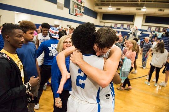 Marbury's Zamari Brown (2) and Samuel Klimek (12) hug after the game during the Class 5A boys subregional in at Marbury High School Deatsville, Ala., on Tuesday, Feb. 11, 2020. Marbury defeated Demopolis 56-46.