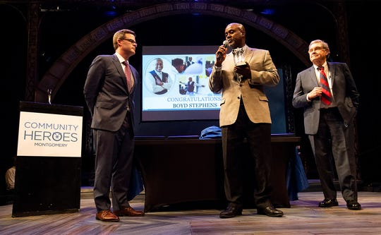 Boyd Stephens, center, is presented the Community Hero of the Year by Bro Krift, left, and Jere Beasley, right, during the Community Hero Celebration at the Alabama Shakespeare Festival in Montgomery, Ala., on Tuesday February 11, 2020.
