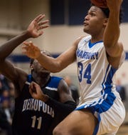Marbury's Reggie Brown (34) goes up for a layup during the Class 5A boys subregional in at Marbury High School Deatsville, Ala., on Tuesday, Feb. 11, 2020.