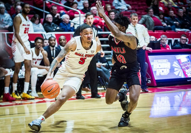 Ball State's Ishmael El-Amin dribbles past NIU's defense during their game at Worthen Arena Tuesday, Feb. 11, 2020.