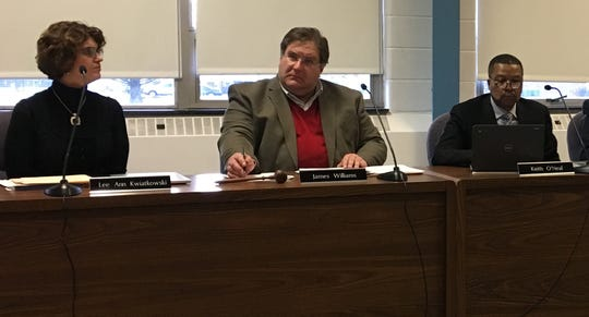 Muncie Commnity Schools CEO Lee Ann Kwiatkowski, school board President James Williams, and board member Keith O'Neal at a board meeting on Feb. 11.