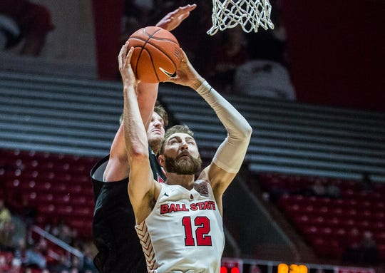 Ball State redshirt junior forward Brachen Hazen goes up for a shot during the Cardinals' 63-59 win against NIU at Worthen Arena Tuesday, Feb. 11, 2020.