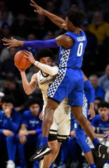 Vanderbilt guard Scotty Pippen Jr. (2) battles Kentucky guard Ashton Hagans (0) during the first half at Memorial Gym in Nashville, Tenn., Tuesday, Feb. 11, 2020.