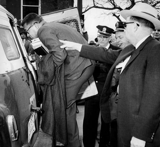 With an arrest warrant in hand, Nashville officers direct the Rev. James Lawson, left, a divinity student who was expelled from Vanderbilt University, into the paddy wagon in front of the First Baptist Church on March 4, 1960.