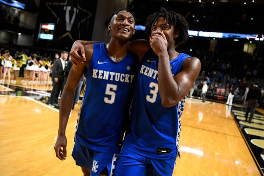 Kentucky guard Immanuel Quickley (5) and guard Tyrese Maxey (3) react after defeating Vanderbilt at Memorial Gym in Nashville, Tenn., Tuesday, Feb. 11, 2020.