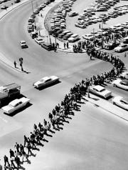 Demonstrators wind their way around the courthouse area in Nashville, coming out from Jefferson Street and James Robertson Boulevard on April 19, 1960. The protesters marched three across in a line 10 blocks long on the day of the Z. Alexander Looby bombing.
