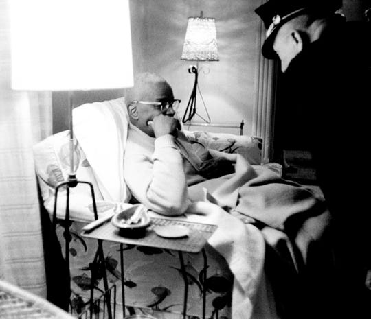 A Nashville policeman checks on city councilman Z. Alexander Looby, left, who is recovering after a 5:30 a.m. dynamite blast wrecked his five-room home on Meharry Boulevard in Nashville. Looby, an attorney for sit-in demonstrators, and his wife weren't injured in the blast that damaged two other residences April 19, 1960.