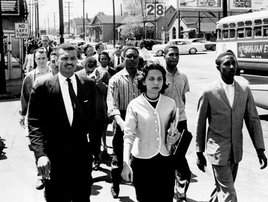 African American leaders march down Jefferson Street at the head of a group of 3,000 demonstrators April 19, 1960, and head toward City Hall on the day of the Z. Alexander Looby bombing. In the first row are the Rev. C.T. Vivian, left, Diane Nash of Fisk University, and Bernard Lafayette of American Baptist Seminary. In the second row are Kenneth Frazier and Curtis Murphy of Tennessee A&I, and Rodney Powell of Meharry. In the third row is the Rev. James Lawson, one of the advisors to the students.