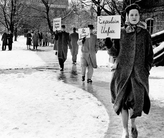 Picketers, most of them divinity school students at Vanderbilt University, parade in front of Kirkland Hall, the school's administration building, on March 4, 1960, to protest the expulsion of the Rev. James M. Lawson Jr., a divinity school student, for his part in recent lunch counter demonstrations.