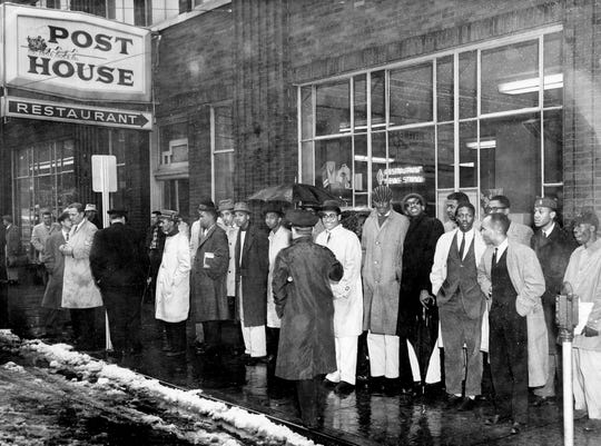A group of Tennessee State A&I students, in front of the Post House Restaurant in downtown Nashville, were among hundreds of demonstrators tramping through rain and slush to continue a sit-in campaign against lunch counter segregation March 2, 1960.