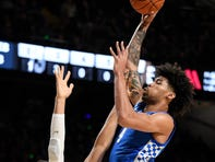 Kentucky forward Nick Richards (4) shoots over Vanderbilt forward Matthew Moyer (13) during the first half at Memorial Gym in Nashville, Tenn., Tuesday, Feb. 11, 2020.
