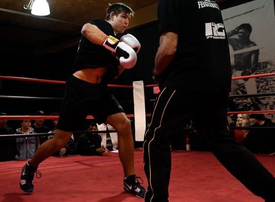 Vincent Feigenbutz hits his trainer's mitts during a media workout at Music City Boxing Gym Wednesday, Feb. 12, 2020, in Nashville, Tenn. Feigenbutz will challenge Caleb Plant for the IBF World Super Middleweight Title on Feb. 15 at Bridgestone Arena.