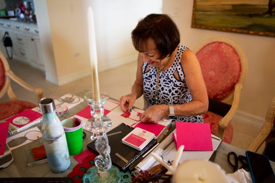 Jan Madigan works on a sympathy card for a neighbor whose husband passed away at her home in Naples on Wednesday, February 5, 2020.