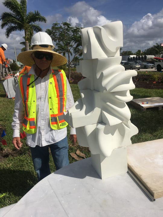 Hungarian-born artist Marton Varo with a scale model of his sculpture La Donna Wednesday at U.S. 41 East and Collier Boulevard. The 15-foot-tall sculpture is being installed at the intersection this week. An official unveiling is set for Feb. 21.