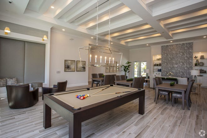 One of two clubhouses at Milano Lakes includes a large entertainment area, as well as a state-of-the-art fitness center and resort-style pool and sunning deck.