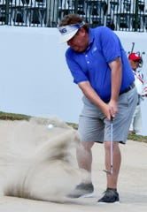 """Tim Herron hits out of a bunker on the 18th green during the Chubb Classic Pro-Am at Lely Resort in Naples on Wednesday. Herron, nicknamed """"Lumpy"""", makes his tour debut this week."""