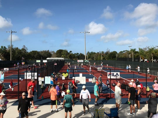 Players wait for pickleball courts to open at East Naples Community Park, Wednesday, Feb. 12, 2020.