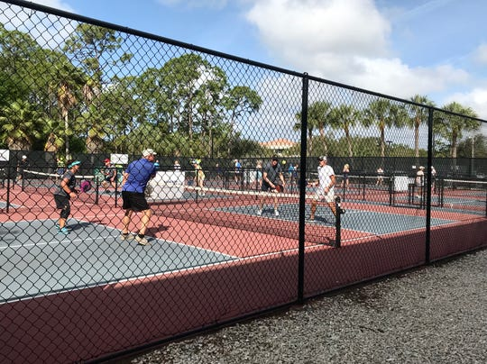 Residents play pickleball at Veterans Community Park in North Naples, Wednesday, Feb. 12, 2020.