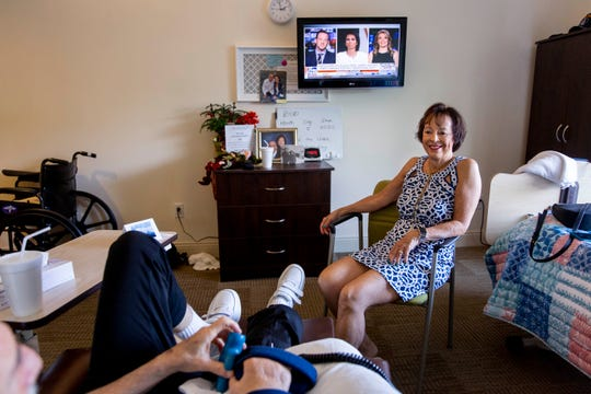 Jan Madigan, right, visits her husband, Bob Madigan, in his room at The Glenview at Pelican Bay in Naples on Wednesday, February 5, 2020. Madigan makes an effort to visit her husband every day when she's able to, but he also has an Amazon Echo Show that allows her to pop in for a video call when she's out of town or unable to make the trip.