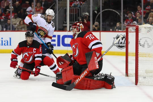 Feb 11, 2020; Newark, New Jersey, USA; Florida Panthers right wing Brett Connolly (10) (not shown) scores a goal on New Jersey Devils goaltender Louis Domingue (70) during the first period at Prudential Center.