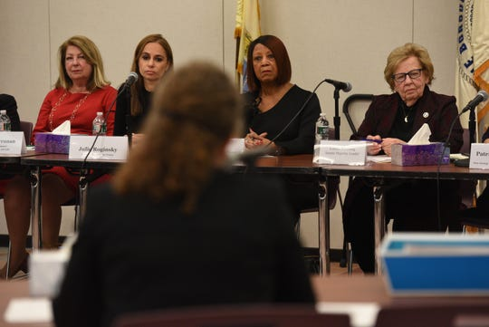 Members of the The Workgroup on Harassment, Sexual Assault and Misogyny in New Jersey Politics, including group founder Senator Loretta Weinberg D-Bergen, Lt. Gov. Sheila Oliver, Julie Roginsky, co-founder of Lift Our Voices and Laurel Brennan, NJ State AFL-CIO secretary, listen to Deborah Cornavaca, deputy chief of staff of outreach for Gov. Phil Murphy, during the first public hearing at the Fort Lee Community Center on Tuesday, Feb. 11, 2020.