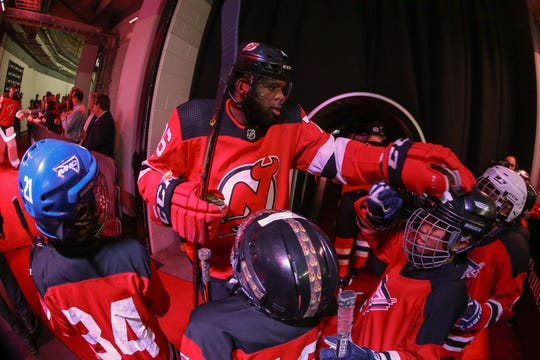 Feb 11, 2020; Newark, New Jersey, USA; New Jersey Devils defenseman P.K. Subban (76) greets some youth hockey players on the way to the ice before the start of the first period against the Florida Panthers at Prudential Center.