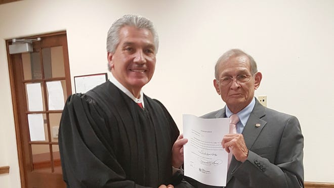 Fernando Macias, left, then a district judge, swears in Mesilla Municipal Judge Lionel Frietze in 2016