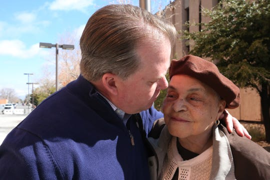Shelton Dodson, CBS 4 anchor out of El Paso and J.R. Stewart's best friend, kisses Stewart's mother outside Las Cruces Federal Court on Wednesday, Feb. 12, 2020. Daniel Lowell, who killed Stewart while being chased by police on  Nov. 27, 2017,  was sentenced to 449 months in prison.