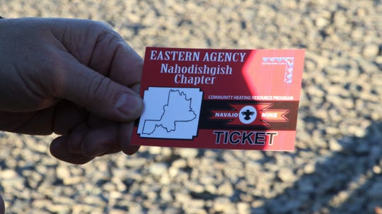 A member of the Nahodishgish Chapter of the Navajo Nation presents a ticket handed out by chapter houses for members to receive free allotments of coal for home heating at Navajo Mine in Fruitland on Feb. 6, 2020.