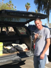 Jason, shown with his painting supplies, is one of Martha's Village & Kitchen's many success stories.