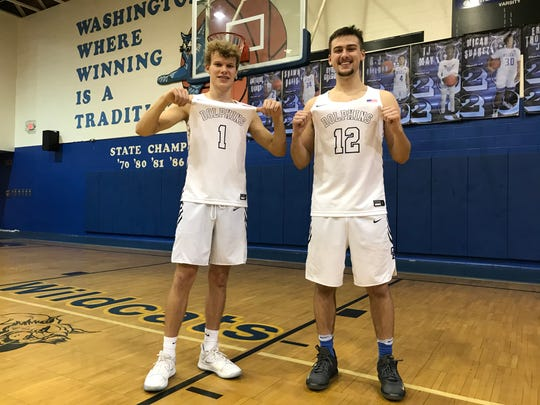 Griffin Corben (#1) and Cole Paschall (#12) made clutch shots for Gulf Breeze basketball in the fourth quarter of Tuesday's district quarterfinal win over Escambia. Corben finished with 20 points.
