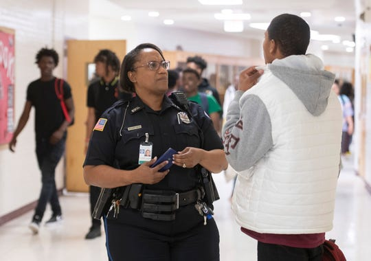 """Pensacola Police Department Officer Mary """"Sharesea"""" Williams-Green interacts with students, teachers and faculty Feb. 12 at Pensacola High School."""