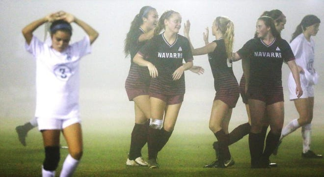 Navarre girls soccer celebrates a goal against Fleming Island in the first round of the FHSAA state tournament. on Feb. 11, 2020.