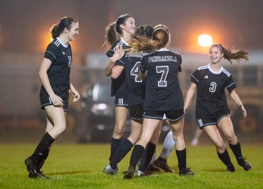 The Tigers celebrate their 8-0 victory during the West Nassau vs. PHS girls FHSAA state tournament game at Pensacola High School on Tuesday, Feb. 11, 2020.