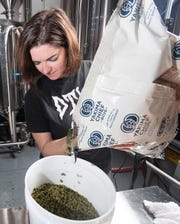 Brandi Rodriguez measures out a portion of hops for exclusive beer recipe at Odd Colony Brewing in downtown Pensacola on Tuesday, February 11, 2020. Women from nine Gulf Coast breweries joined together to make an exclusive beer to help commemorate International Women's Day on March 8.
