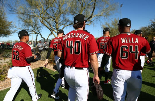 Arizona Diamondbacks starting pitcher Madison Bumgarner (40) and his new teammates report for the first day of spring training workouts on Feb. 12, 2020, at Salt River Fields at Talking Stick in Scottsdale, Ariz.