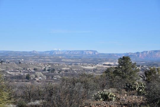 The San Francisco Peaks in Flagstaff can be seen in the distance from Ryal Canyon.