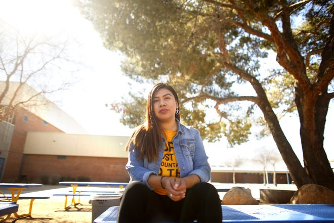 Viri Hernandez, an activist pushing for police reforms, speaks to those who came by the Poder in Action table at Carl Hayden High Community School in Phoenix, on Saturday, Feb. 8, 2020.