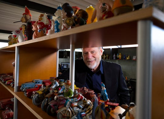 Peter Shikany, president of PS Studios in Phoenix, has worked with many big name clients like Phoenix Art Museum, Ballet Arizona, MIM and ASU Art Museum. Shikany's office is decorated with antique toys.