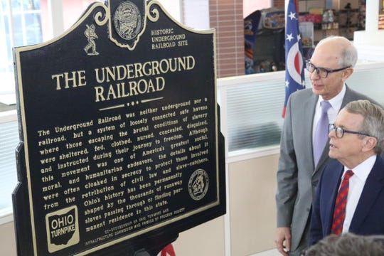 Governor Mike DeWine unveiled historical markers for the Underground Railroad placed at four Ohio Turnpike service plazas, including two in Clyde, on Wednesday.
