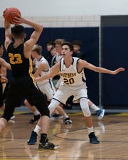 Port Huron Northern's Cass Dobrowolski guards Sterling Heights' Anthony Danno Tuesday, Feb. 11 during their basketball game at Port Huron Northern High School.