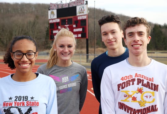 Arlington's, from left, Jalyssa Smith, Rebecca Fastiggi, Alex Segarra and Daniel Caso before practice in Freedom Plains on February 12, 2020.