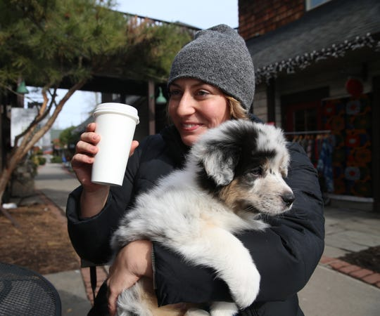 Emma Jacoby with her new puppy, Dixie, at Water Street Market in the Village of New Paltz on February 12, 2020.
