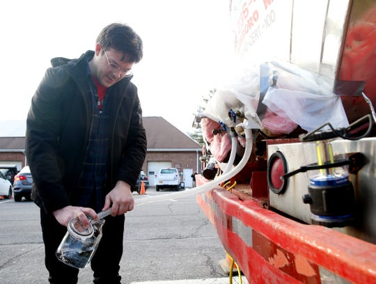 Brendan Boland fills a container with clean drinking water at the New Paltz Village Hall on February 12, 2020.