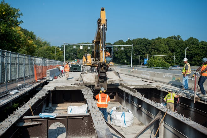 Construction crews rip out old panels of bridgework to make way for new panels on the Newburgh-Beacon bridge in Newburgh in this September 2015 file photo.