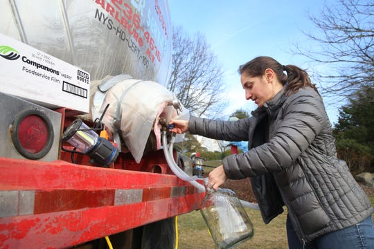 Elise Cimino fills a container with clean drinking water at the New Paltz Village Hall on February 12, 2020.