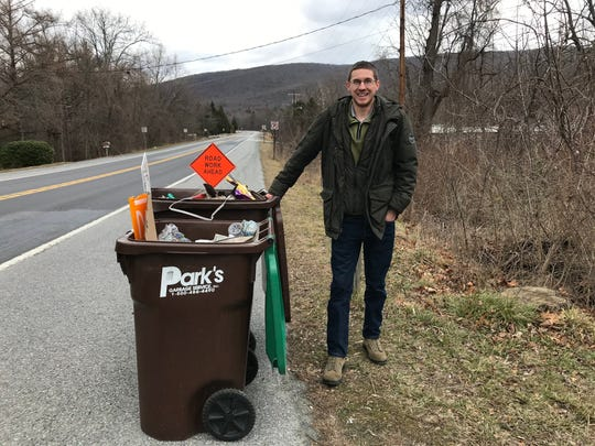Scott Willard, 27, of Fayetteville, regularly cleans litter off of his property and his alongside his neighbors' properties. He will usually fill multiple trash bags full of discarded plastics, food containers and more.